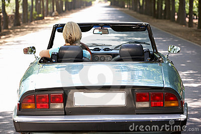 Woman driving sports car