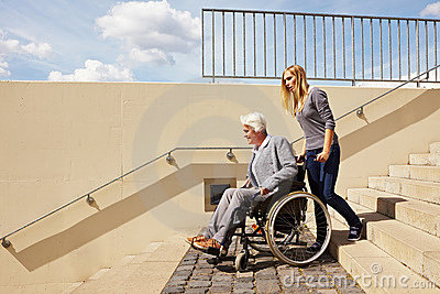 Woman driving wheelchair downstairs