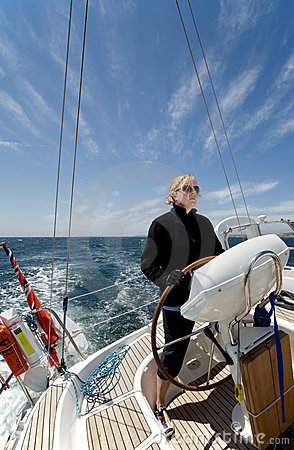 Woman driving yacht