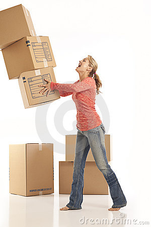 Woman dropping cardboard boxes