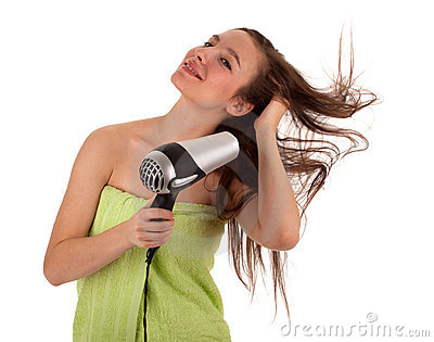 Woman drying her hair by dryer