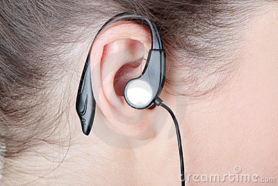 Woman ear with headphones