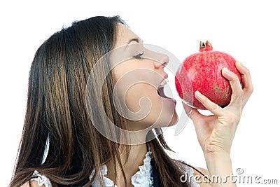 Woman eat or bite Pomegranate fruit