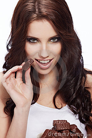Woman eat a chocolate