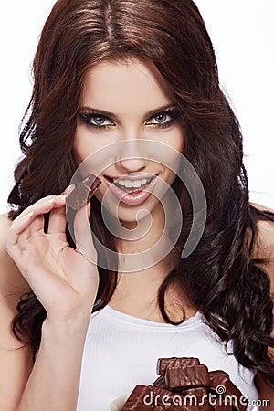 Woman eat a chocolate