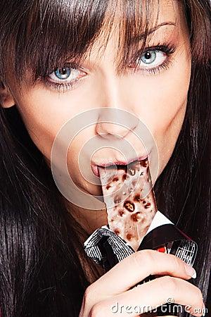 Woman eat chocolate bar