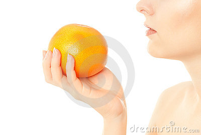 Woman eat grapefruit isolated on white
