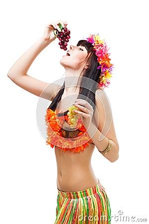 Woman eat grapes wearing bikini made of flowers