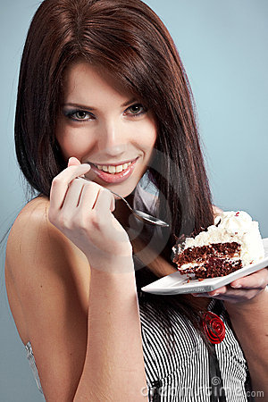 Woman  eat a slice of a sweet cake