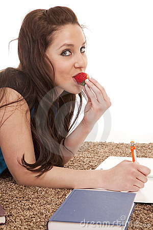 Woman eat strawberry homework smile