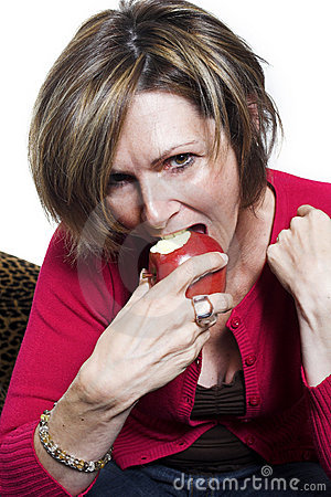 Woman eating and apple