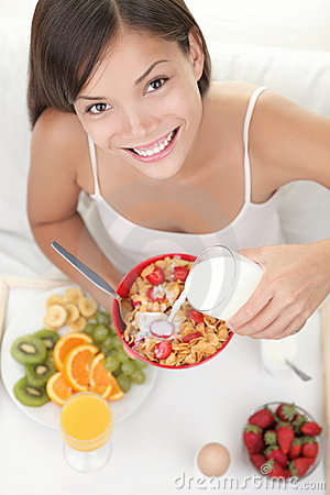 Free Woman Eating Breakfast In Bed Stock Photography - 17268702