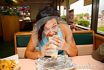 Woman eating burrito