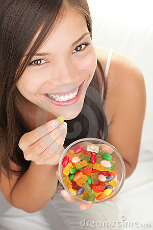 Woman eating candy Editorial Stock Image