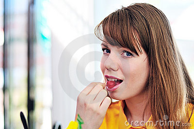 Woman eating cherry