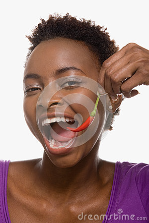 Free Woman Eating Chili Pepper Stock Photography - 62561982