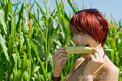 Woman eating a Corncob