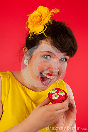 Woman eating cupcakes