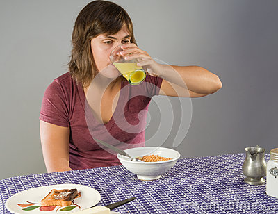 Woman eating gluten-free breakfast