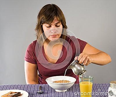Woman eating gluten-free breakfast