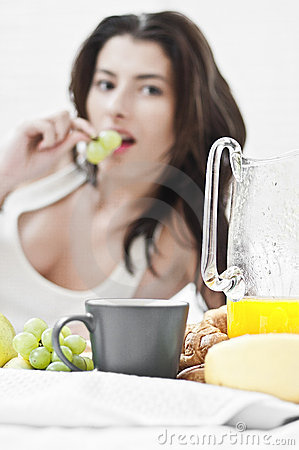 Woman eating grapes in the morning