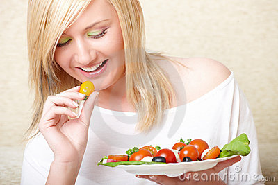Woman eating healthy food, Greek salad