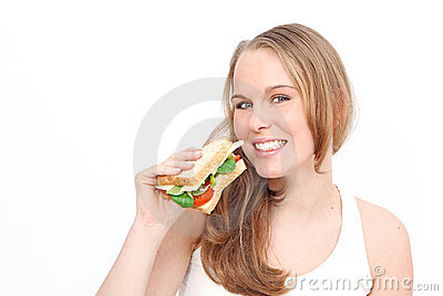Woman eating healthy sandwich