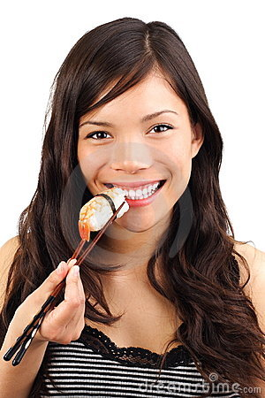 Woman eating healthy sushi