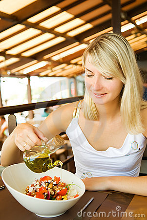 Woman eating healthy vegetables