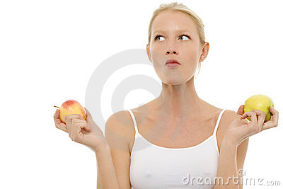 Woman eating and holding apples in the hands