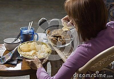 Woman eating junk food_2