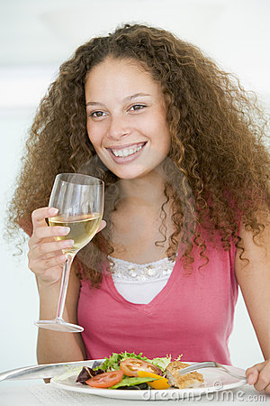 Woman Eating meal,mealtime With A Glass Of Wine