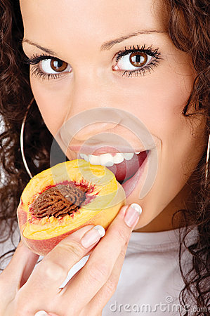 Woman eating peach