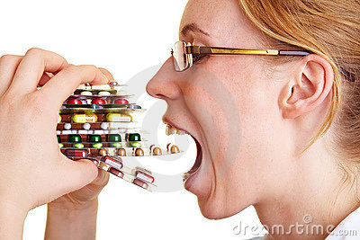 Woman eating pills