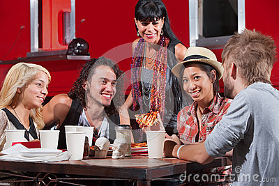 Woman Eating Pizza with Friends