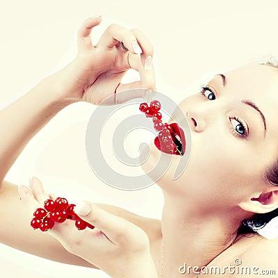 Woman eating red berries