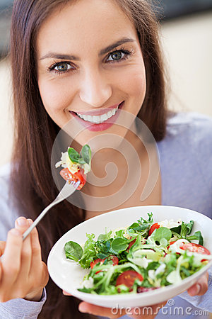 Free Woman Eating Salad Stock Images - 30551704