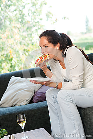 Free Woman Eating Sandwich Lunch Breakfast Home Sofa Royalty Free Stock Photos - 28711758