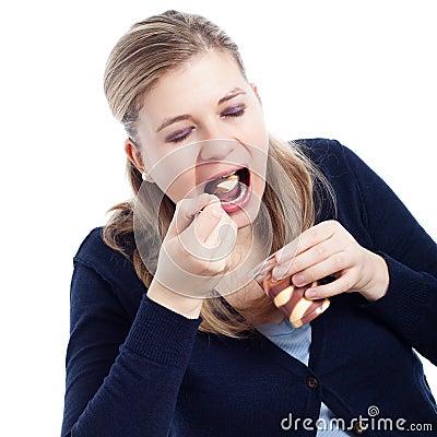 Woman eating sweet creamy dessert