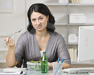 Woman Eating a Tasteless Lunch
