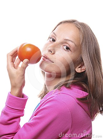 Woman eating a tomato, isolated