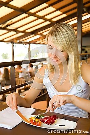 Woman eating vegetarian food