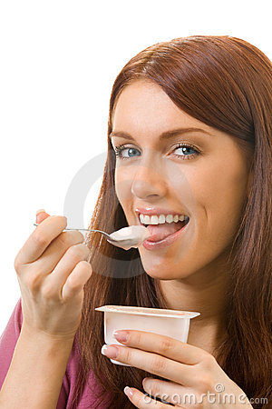 Woman eating yogurt, isolated