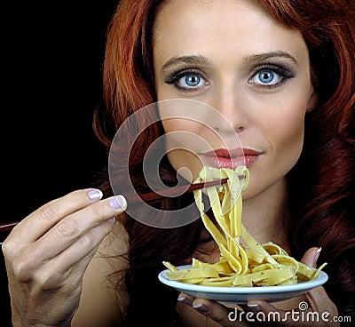 Woman Eats pasta