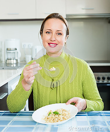 Free Woman Eats Rice Stock Image - 64549331
