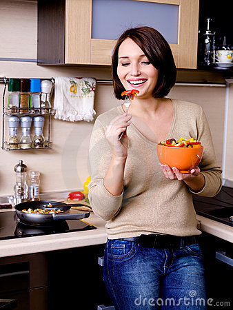 Woman eats vegetable s salad