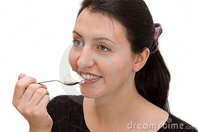 Woman eats yoghurt