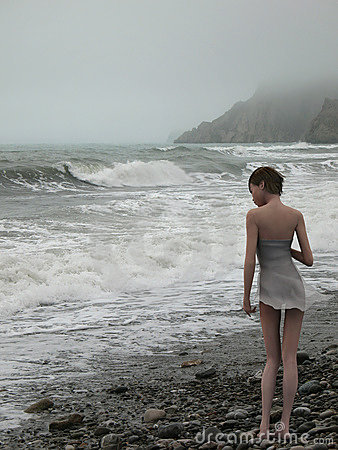 Woman on edge of the stormy sea
