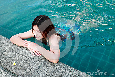 Woman at the Edge of Swimming Pool