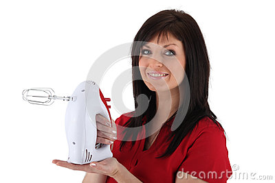 Woman with an electric mixer